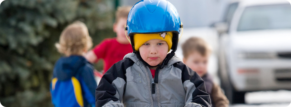 Boy dressed with a protection gear