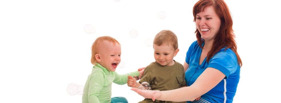 babies playing bubbles with their parent
