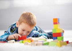 a boy building blocks