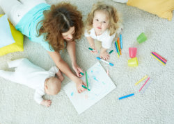 an infant and toddler doing art