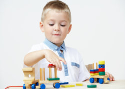 a boy building blocks